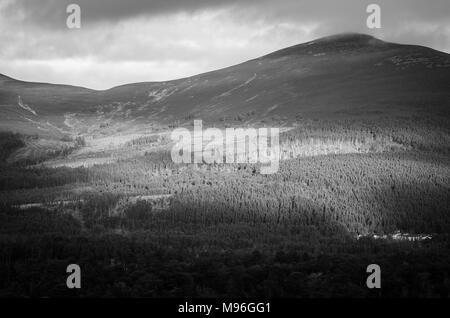 Contrasts of Sun and Shadow playing across the Scottish Highlands - Stock Image