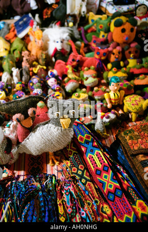 Close up of Mexican fabric crafts focused on knitted owl figure - Stock Image