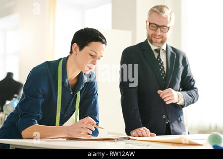 Discussing details - Stock Image