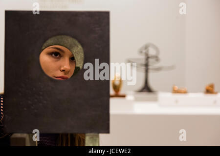 London, UK. 15 June 2017. A Sotheby's employee looks at the Barbara Hepworth sculpture Four-Square (Four circles), - Stock Image
