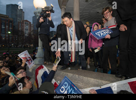 Boston, USA. 10th Apr, 2019. Boston, MA, USA. YANG 2020 American presidential campaign rally at the Parkman Bandstand on the Boston Common. More than 1,000 supporters of Andrew Yang gathered to meet and hear Democratic candidate Yang speak at the Boston Common. Photo shows Yang, who has authored several books signing books and posters after the event. Credit: Chuck Nacke/Alamy Live News - Stock Image