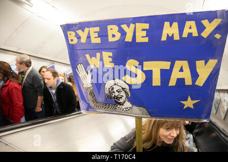 Woman with placard on London Underground escalator, People's Vote March, London, England - Stock Image
