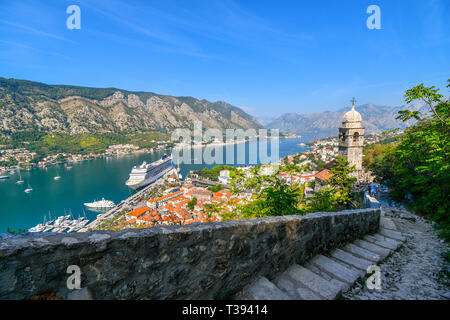 Steep steps reach the tower of Saint John Church, part of the ruins of the Castle Fortress of San Giovanni, overlooking the Bay in Kotor, Montenegro - Stock Image