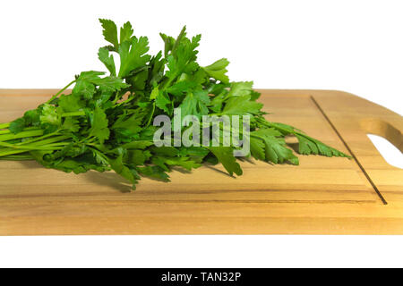 Bunch of parsley on a cutting board - Stock Image