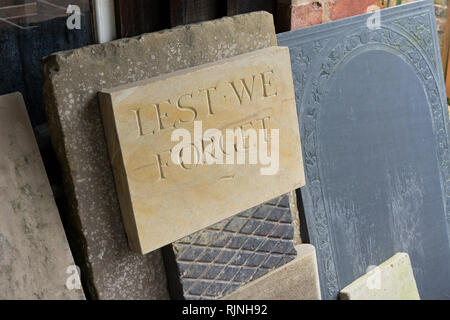 Materials in a recreated stone masons yard, including one inscribed 'lest we forget', Blists Hill Victorian Town, Shropshire, UK - Stock Image