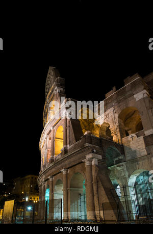 Glimpse of the Colosseum at night, in Rome illuminated by artificial  light - Stock Image