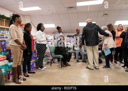 Opelika, Alabama, USA. 08th March, 2019. U.S President Donald Trump meets with residents at the Providence Baptist Church relief center March 8, 2019 in Smiths Station, Alabama. The region was hit by a tornado on March 3rd killing 23 people. Credit: Planetpix/Alamy Live News - Stock Image