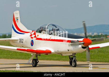 Croatian Air Force Pilatus PC-9 trainer aircraft taxiing after landing - Stock Image