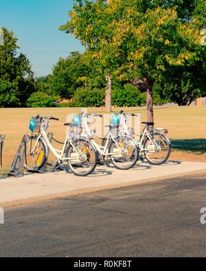 Bicycle rentals, bike share, near tourist attraction in Wichita, Kansas, USA. - Stock Image