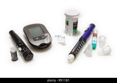 Diabetic set of lancet with spare needles, glucometer, strips, box of spare strips, pen injector, spare insulin and pen needles isolated on white back - Stock Image