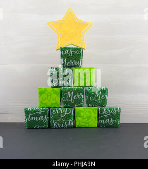 Stack of Gifts and Yellow Star on top - Stock Image