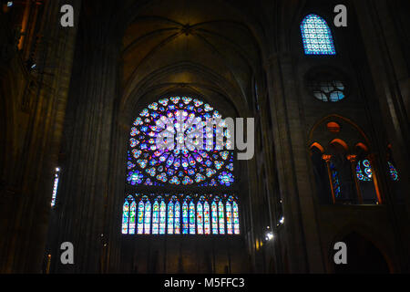 The North Rose window and lancet windows on the interior of the Notre Dame de Paris cathedral in Paris France with - Stock Image