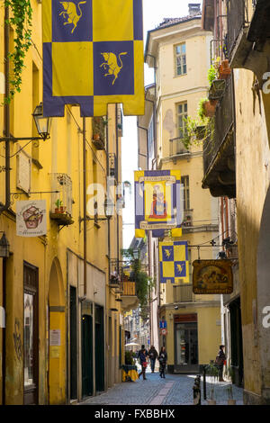 Contrada flags in a back street in Turin, Piedmont, Italy - Stock Image
