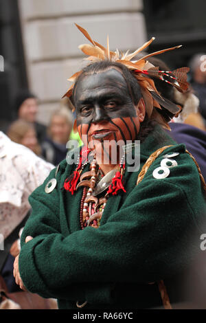 London, UK. 1st January, 2019. A Warrior of Anikituhwa posed for photos ahead of the annual New Years parade in the street of London. About 8,000 performers representing the London boroughs and over 20 countries from across the globe take part on the annual New Years Parade on the street of London on January 1, 2019. The parade will as is custom include dancers, acrobats, cheerleaders, marching bands, historic vehicles and huge balloons making their way from Green Park Tube station to Parliament Square. Credit: david mbiyu/Alamy Live News - Stock Image