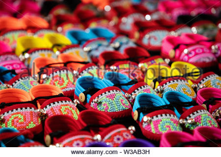 Colorful handmade kids sandals on street market in Thailand - Stock Image