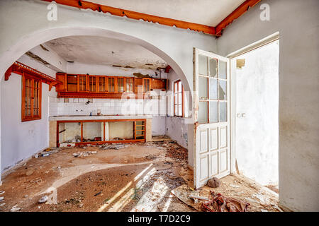 Kitchen interior of an abandoned ruin house - Stock Image