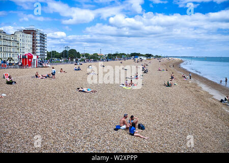 A view along Southsea beach looking east from the pier showing the pebbles - Stock Image