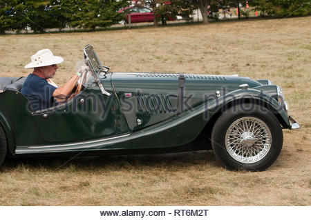 Man in a classic Morgan car with a hood strap at the Virginia Scottish Games. - Stock Image