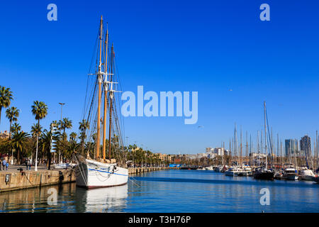 Tall ship and yachts moored in Port Vell marina, Barcelona Spain. - Stock Image