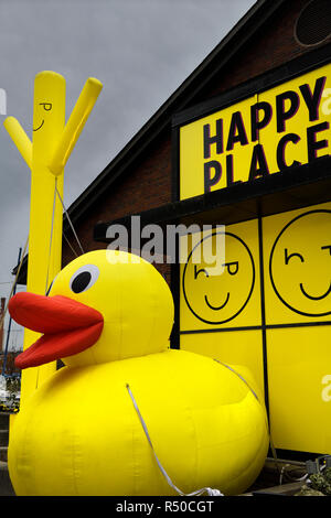 Giant inflatable man and yellow rubber ducky at Happy Place pop-up interactive art installation at Toronto Harbourfront Centre - Stock Image