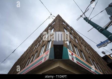 TORONTO, CANADA - NOVEMBER 13, 2018: 7 Eleven logo in front of their local shop in Spadina avenue in Toronto. 7-Eleven is an American brand of conveni - Stock Image