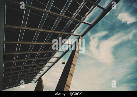Wide angle view from bottom of modern hi-tech solar photovoltaic panel with empty space for your message on the - Stock Image