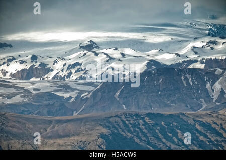 Dramatic sky over mountain range and glacier, Skaftafell National Park, Iceland - Stock Image