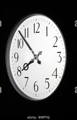 Retro Clock Face Symbolizing Good Time Keeping - Stock Image