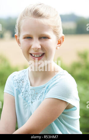 Outdoor Head And Shoulders Portrait Of Girl - Stock Image