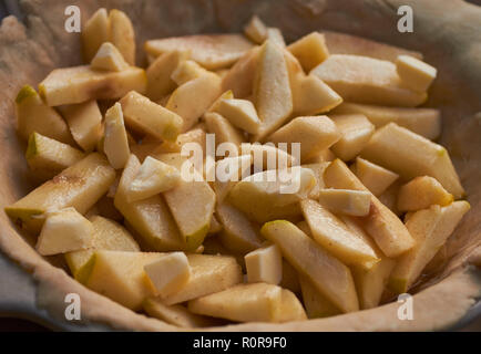 An apple pie before the top crust has been put in place - Stock Image