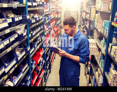 auto mechanic or smith with tablet pc at workshop - Stock Image