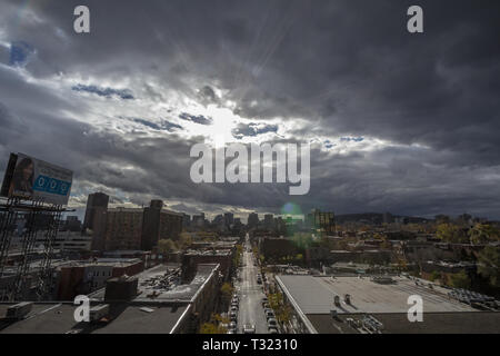 MONTREAL, CANADA - NOVEMBER 8, 2018: Montreal skyline, with the iconic buildings of the CBD business skyscrapers taken from the residential district o - Stock Image