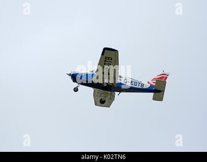 Piper PA-28-161 Warrior on a visit from Tayside Aviation Ltd on the short flight to Inverness airport in the Scottish highlands. - Stock Image