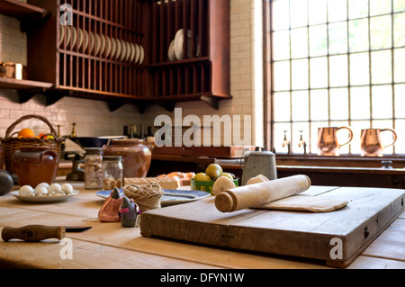 Rustic country style kitchen with cooking utensils. - Stock Image