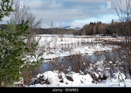 A winter landscape or snowscape of the Sacandaga River valley near Speculator, NY USA in the Adirondack Mountains. - Stock Image