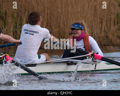 Cox giving instruction to rowers from the University of Exeter boat club, Devon, UK - Stock Image