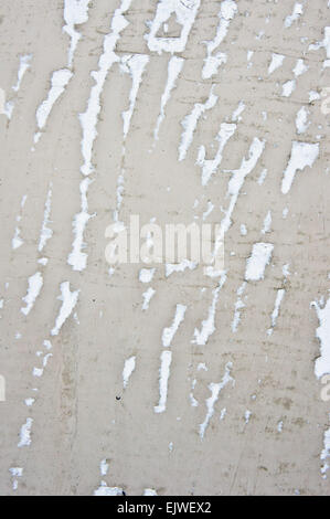 Scuffs in a stone surface as a background texture - Stock Image