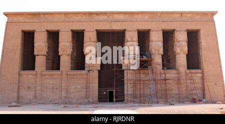 The facade of Temple of Hathor, Dendera, Egypt. It is one of the best-preserved temple complexes in Egypt. The Hathor temple (Temple of Tentyra) has been modified on the same site starting as far back as the Middle Kingdom, and continuing right up until the time of the Roman emperor Trajan. The existing structure was built no later than the late Ptolemaic period. The temple, dedicated to Hathor, is one of the best preserved temples in all Egypt - Stock Image