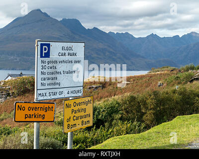 Parking restriction signs at Elgol carpark with the Black Cuillin mountains behind on the Isle of Skye, Scotland, UK - Stock Image
