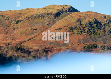 Silver How above a misty lake at Grasmere, Lake District, Cumbria - Stock Image