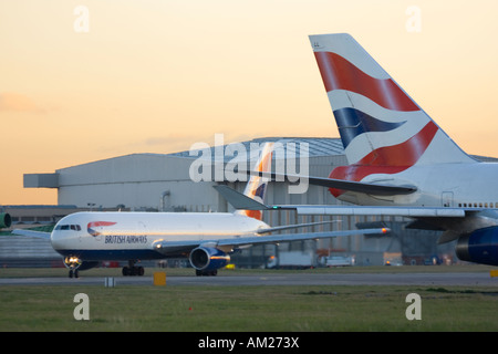 British Airways aeroplanes taxiing for departure at Heathrow Airport London UK - Stock Image