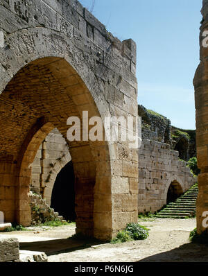 Syria. Talkalakh District, Krak des Chevaliers. Crusader castle, under control of Knights Hospitaller (1142-1271) during the Crusades to the Holy Land, fell into Arab control in the 13th century. Inside of the enclosure. Photo  taken before the Syrian Civil War. - Stock Image