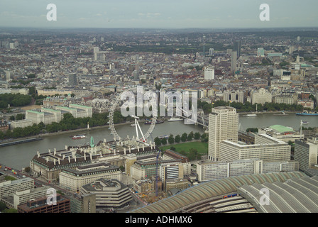 Aerial view of the London Eye and County Hall overlooking the River Thames, Charing Cross Station and Whitehall in London - Stock Image