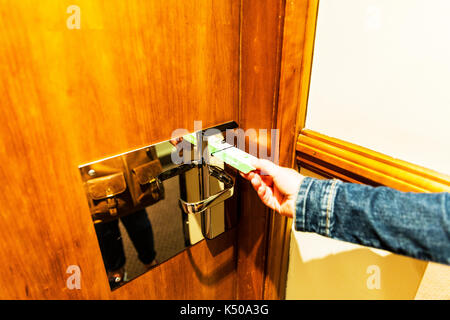 Key Card, using key card, Hotel key card, unlocking door, unlocking door with key card, key card security, door card, hotel door card, card, cards, - Stock Image