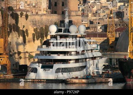 The 147-metre Lurssen superyacht Topaz undergoing maintenance in dry dock at the Palumbo dockyard in Malta - Stock Image