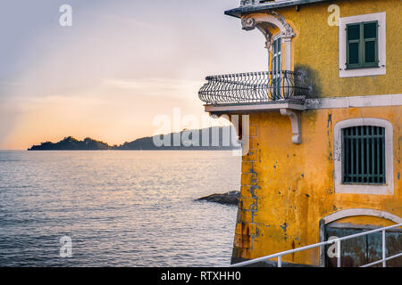 small terrace overlooking the sea at sunset in the luxurious ancient villa on the Gulf of Tigullio near Portofino in Liguria - Italy - Stock Image