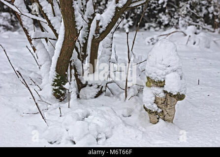 GLawn Gnome covered in snow - Stock Image