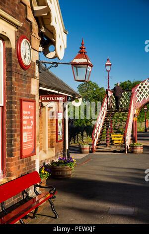 UK, Cumbria, Eden Valley, Appleby Station, Settle to Carlisle Line, historic clock, lamp and footbridge - Stock Image