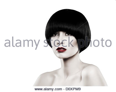 Young woman with black bob looking away - Stock Image