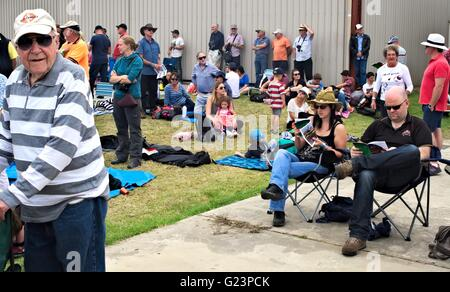 Mixed crowd of Australian people at Tyabb Airshow, waiting for the next plane to go up. - Stock Image